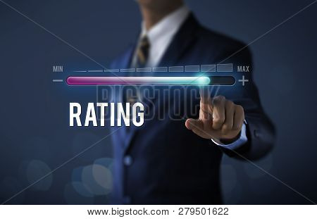 Increase Rating, Rating Raised Or Business Growth Concept. Businessman Is Pulling Up Progress Bar Wi