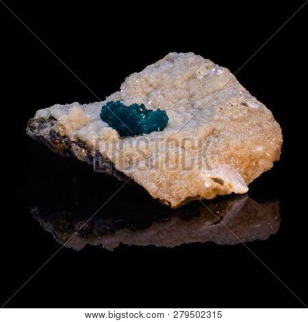 Natural Cavansite Stone On Substrate On Black Background With Reflection