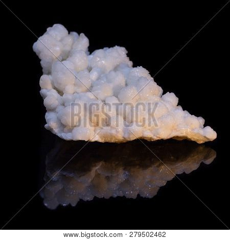Natural Druse Of White Calcite On A Black Background With Reflection