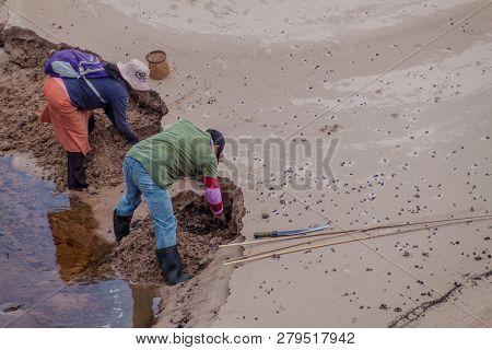 Gran Sabana, Venezuela - August 13, 2015: Indigenous Fishermen Are Looking For Worms In Gran Sabana