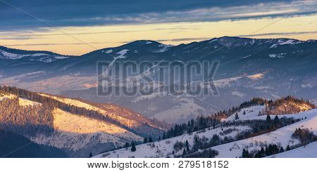 Winter Sunrise In Mountains. Beautiful Carpathian Wonderland. Countryside With Snow Covered Rolling
