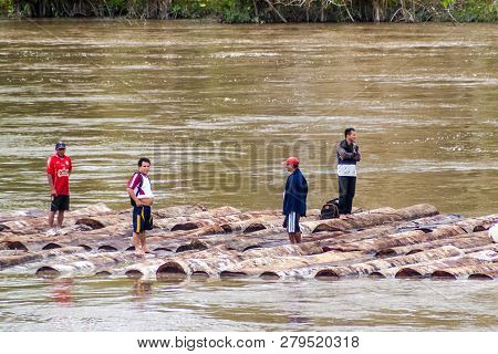 Napo, Peru - July 16, 2015: Local People Transport Logs On River Napo