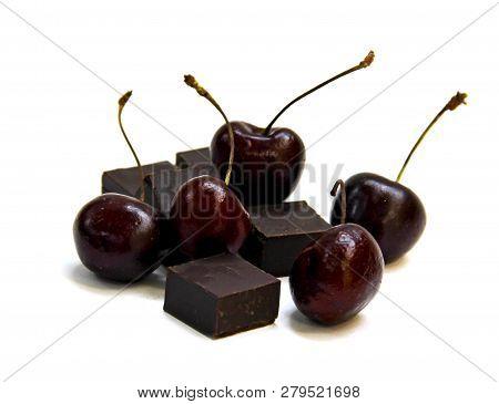 Black  Chocolate Lump And Dark Large Cherry Isolated On White