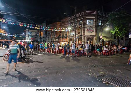 Manaus, Brazil - July 26, 2015: People On A Street And In A Bar.
