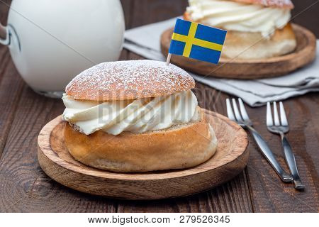 Traditional Swedish Dessert Semla, Also Called Shrove Bun, With Almond Paste And Whipped Cream Filli