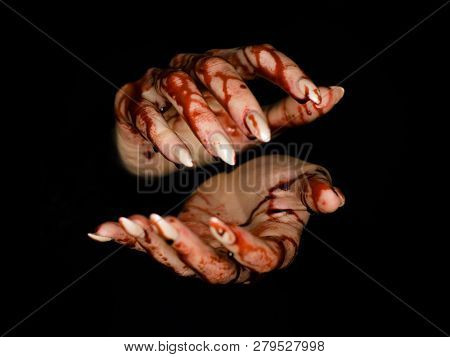 Scary Zombie Hand On Dark Background. Maybe Useful For Some Halloween Concept