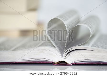 Close-up Of Heart Shape From Paper Book Against White Background. Love For The Books