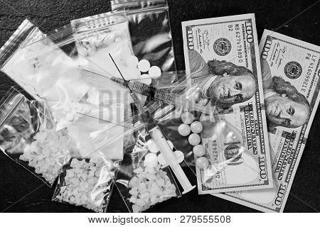Drugs On The Table Photo Toned In Retro Style. There Are Different Types Of Drugs And Dollars Money.