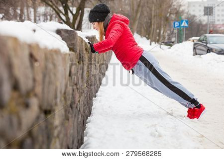 Outdoor Sport Exercising, Sporty Outfit Ideas. Woman Wearing Warm Sportswear Urban Training Exercisi