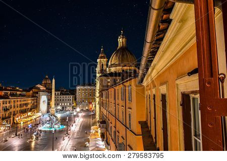 Rome, Italy - September 30 2018: The Illuminated Dome Of Sant Agnese In Agone, Or St. Agnes Cathedra