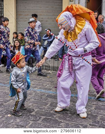Latacunga, Ecuador - September 22, 2018 - A Clown Leads Each Neighborhood Group In The Mama Negra Pa