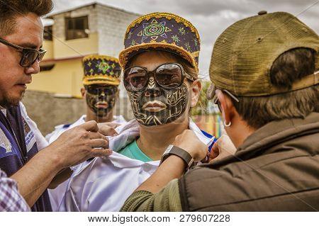 Latacunga, Ecuador - September 22, 2018 - Young Men Dress In Decorated Black Face To Celebrate Afric