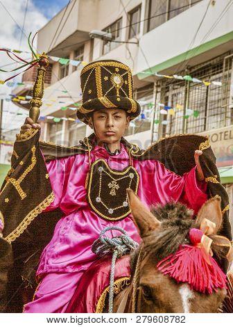 Latacunga, Ecuador - September 22, 2018 - Boy Dresses As A Prince Rides Through Parade Shouting Warn
