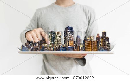 Real Estate Business And Investment, Building Technology. A Man Using Digital Tablet With Modern Bui