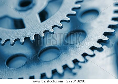 Two Toothed Steel Gears With Copy Space And Focus To The Smaller Gear At The Top In A Concept Of Ind