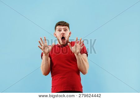Im Afraid. Fright. Portrait Of The Scared Man. Business Man Standing Isolated On Trendy Blue Studio