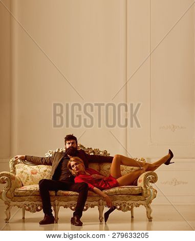 Family Couple. Family Relax On Sofa. Family Life And Everyday Routine. Family Of Sexy Woman And Bear