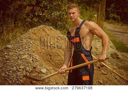 Digger Concept. Manual Digger Man With Shovel. Digger Dig Ground. Strong Digger In Working Uniform.