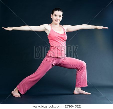 Yoga. Young girl goes in for sports. poster