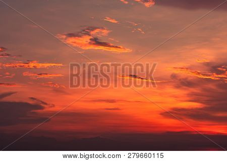 Dramatic Red And Orange Sky And Clouds Abstract Background. Red-orange Clouds On Sunset Sky. Warm We