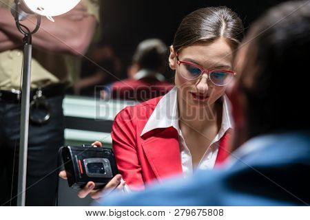Portrait of a female police detective audio recording the statement of a suspect or a witness, during the investigation of a criminal case at the police station