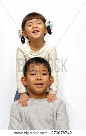 Japanese Brother And Sister (9 Years Old Boy And 4 Years Old Girl)