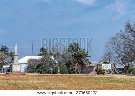 Hopetown, South Africa, September 1, 2018: A Street Scene, With Two Monuments, In Hopetown In The No