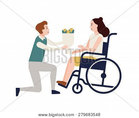 Smiling Man Giving Bouquet Of Flowers To Disabled Woman Sitting In Wheelchair. Girl With Physical Di