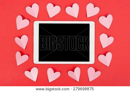 Valentines Day Background With Touchpad And Paper Hearts. Flat Lay.