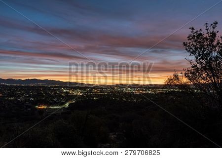 Dawn view towards Burbank and Griffith Park from Santa Susana Mountains hilltop in Los Angeles, California.