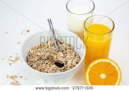 Balanced Breakfast With Muesli Bowl, Milk And Fresh Orange Juice