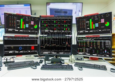 Display Of Stock Market Quotes And Chart In Monitor Computer Room With Business Office Equipments .b