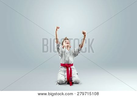 Creative Background, A Child In A White Kimono Rejoices Victory, On A Light Background. The Concept