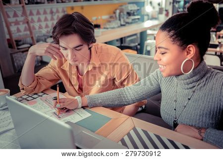 Student Pointing On The Mistake In Other Students Work
