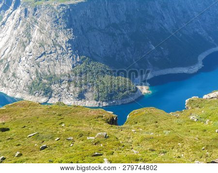Popular Tourist Attraction Near Trolltunga In Sunny Weather. View From The Trolltunga Trail. Mountai