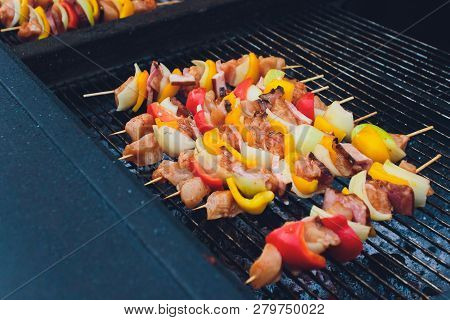 Barbecue Kabobs Smoking On The Grill. Smoked Meat And Vegetables. Grilling Kebabs On The Barbeque. S