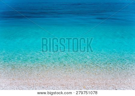 Abstract Image Of Clear Blue Sea Water Beautiful Background Decoration Of Summer Time. Clear Transpa