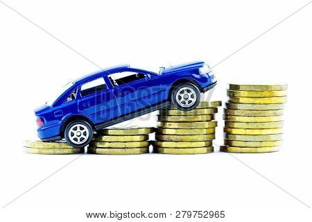 Model Of Blue Car And Coins On A White Background