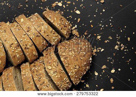 Sliced Multigrain Bread On Black, Top View