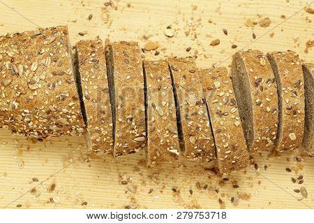Sliced Multigrain Bread On Wood, Top View