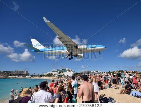 St Martin, Dutch Antelles - December 25, 2018: Klm Heavy Jet Lands Low Over Maho Beach, St Martin. T
