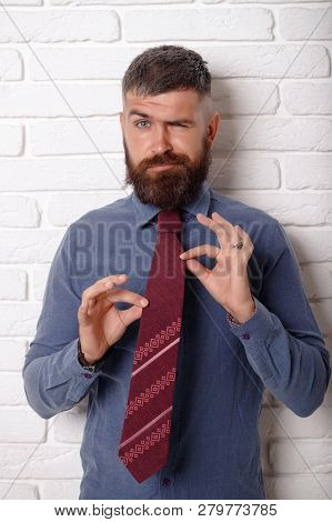 Stylish Hipster Concept. Cheerful Man In Fashion Shirt Smiling. Tie. Tying Tie. Caravat.