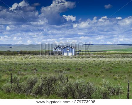 Country Side Blue House In A Field In Usa