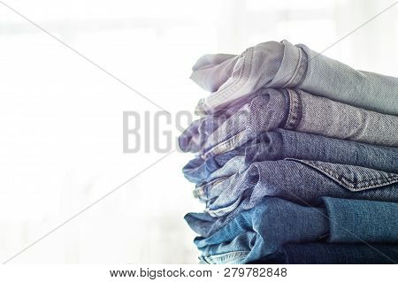 Jeans Background.jeans On A Light Background. Detail Of Nice Blue Jeans. Jeans Texture Or Denim Back