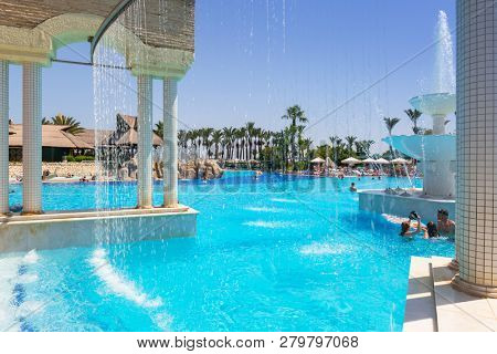 Side, Turkey - June 7, 2018: Beautiful pool area of the TT Pegasos World resort near Side, Turkey. Pegasos World Hotel is a 4-star resort with 9600 square metres of pool areas.