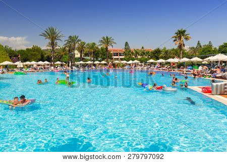 Side, Turkey - June 8, 2018: Beautiful pool area of the TT Pegasos World resort near Side, Turkey. Pegasos World Hotel is a 4-star resort with 9600 square metres of pool areas.