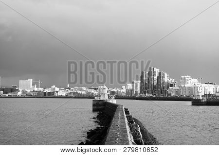 Seascape And Skyline With Bright Lighthouse. Sea Port Navigation Concept. Sea Transportation And Nav