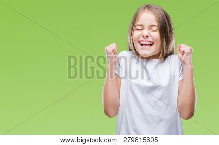 Young beautiful girl over isolated background excited for success with arms raised celebrating victory smiling. Winner concept.