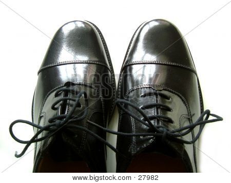 black leather polished shoes poster