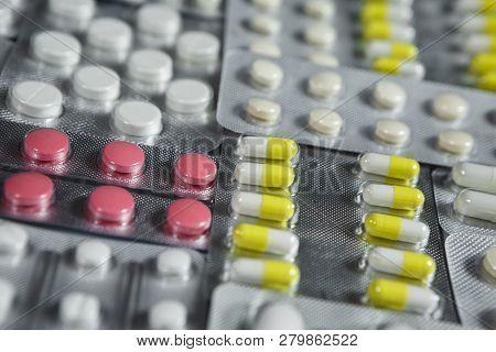 Pharmaceuticals antibiotics pills medicine. colorful antibacterials pills on white background. capsule pill medicine poster